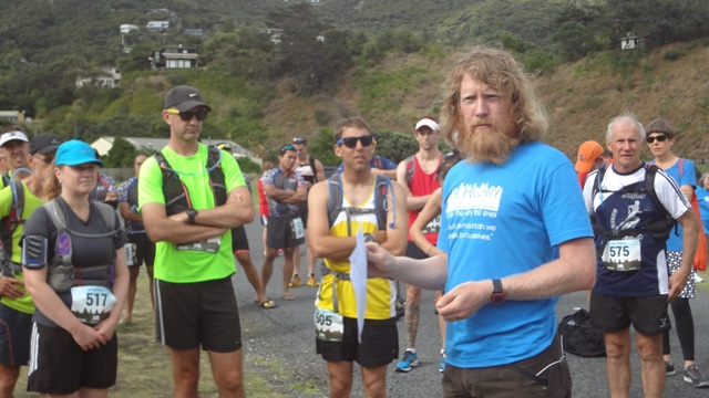 Organiser Shaun Collins gives instructions at Piha Domain