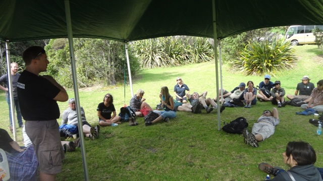 Nick Waipara (left) talking to walkers back at Piha