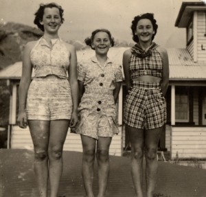 Margaret Browne on the left, outside Piha surfclub, 1941