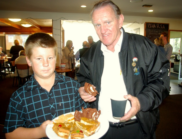 Cody Lucas with Shirley Atkinson's sponge and John Crichton at the Razza