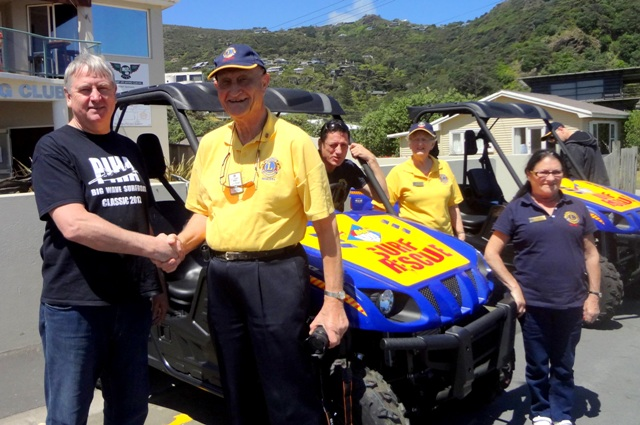 Peter Brown with Cyril Moore of Remuera Lions Club, outside the clubhouse with new vehicles