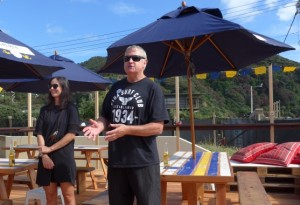 Peter Brown, club president, open the bar. Stephanie, Corona marketing manager to left.