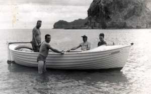 Warwick as a boy with the Harmony. His father Alf is standing in the boat